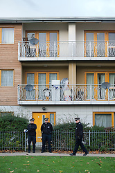 ©  London News Pictures. 23/11/2013. London, UK. Police guard the entrance to a block of flats on Peckford Place, South London, which have been revealed as the location where three women where held captive as slaves for 30 years. The actual flat within the block is currently unknown. The alleged captors were arrested and questioned but have since been released on bail. Photo credit : Ben Cawthra/LNP