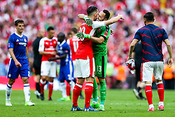 Shkodran Mustafi and David Ospina celebrate after Arsenal win the match 2-0 to become FA Cup Winners - Rogan Thomson/JMP - 27/05/2017 - FOOTBALL - Wembley Stadium - London, England - Arsenal v Chelsea - FA Cup Final.