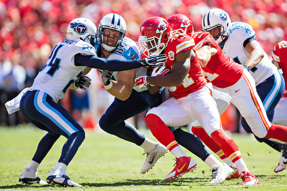 KANSAS CITY, MO - SEPTEMBER 7:  Knile Davis #34 of the Kansas City Chiefs runs the ball and runs into Taylor Thompson #84 of the Tennessee Titans at Arrowhead Stadium on September 7, 2014 in Kansas City, Missouri.  The Titans defeated the Chiefs 26-10.  (Photo by Wesley Hitt/Getty Images) *** Local Caption *** Knile Davis; Taylor Thompson
