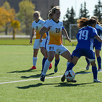 1st year defender Lauren Petras (21) of the Regina Cougars in action during the women's soccer home game on October 1 at U of R Field. Credit: Arthur Ward/Arthur Images