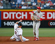 Phillies second baseman Chase Utley throws to first while avoiding Kelly Johnson's slide during the game between the Atlanta Braves and the Philadelphia Phillies at Turner Field in Atlanta, GA on April 30, 2007..