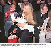 Elizabeth Scarlett Jagger, Jerry Hall, baby Gabriel Jagger and artist Lucian Freud. Bella Freud. Cafe Royal. London.23/2/98. Film 9849f37<br />© Copyright Photograph by Dafydd Jones<br />66 Stockwell Park Rd. London SW9 0DA Tel 0171 733 0108