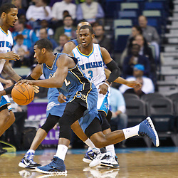 February 1, 2011; New Orleans, LA, USA; Washington Wizards point guard John Wall (2) drives past New Orleans Hornets point guard Chris Paul (3) during the first quarter at the New Orleans Arena.   Mandatory Credit: Derick E. Hingle