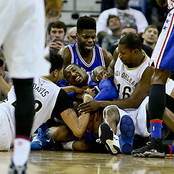 Feb 19, 2016; New Orleans, LA, USA; Philadelphia 76ers forward Robert Covington (33) and forward Nerlens Noel (4) fight for a loose ball with New Orleans Pelicans forward Anthony Davis (23) and New Orleans Pelicans guard Toney Douglas (16) during the second half of a game at the Smoothie King Center. The Pelicans defeated the 76ers 121-114. Mandatory Credit: Derick E. Hingle-USA TODAY Sports