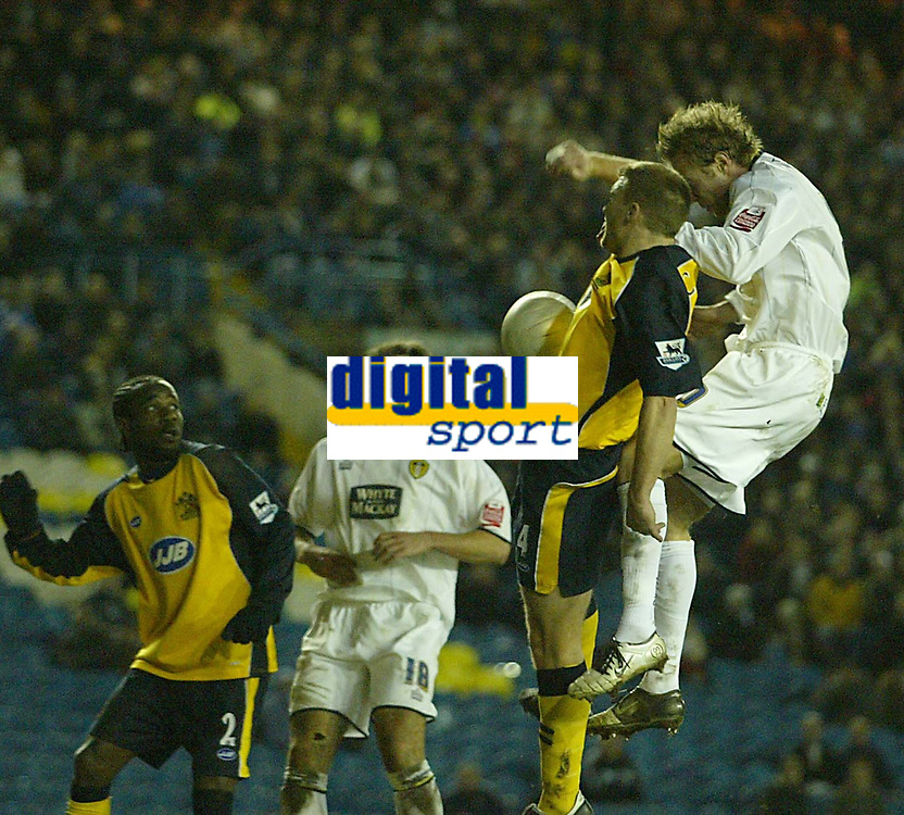 Photo: Aidan Ellis.<br /> Leeds United v Wigan Athletic. The FA Cup. 17/01/2006.<br /> Wigan's Matt Jackson handles the ball in front of Leeds Rob Hulse to give away a penalty to Leeds
