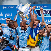 Manchester City players, staff, and fans celebrate after winning the 2013/14 Premiership title with a 2-0 victory over West Ham.