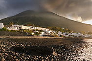 Clouds at the volcano and sunset at the beach of Stromboli, Liparic Islands, Italy