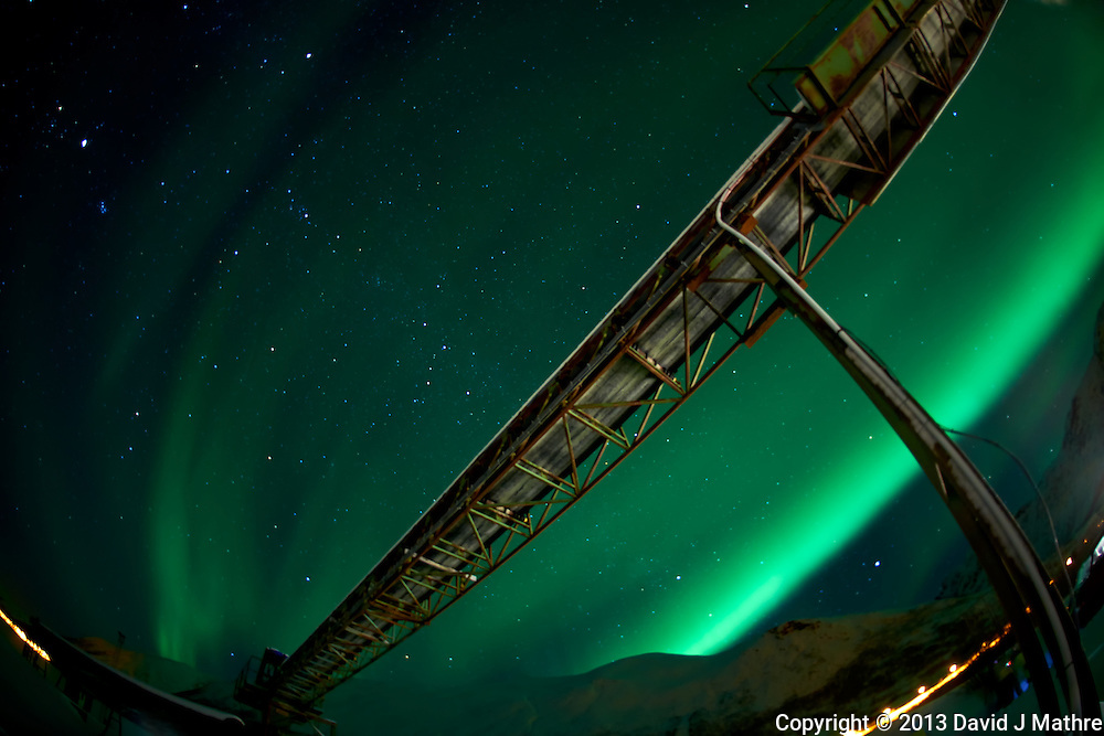 Northern Lights and Coal Mine on Kvaløy (Whale) island in Norrway. Image taken with a Nikon D800 and 16 mm f/2.8 fisheye lens (ISO 800, 16 mm, f/2.8, 30 sec)..