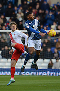 Birmingham City midfielder David Davis and Charlton Athletic midfielder Johann Berg Gudmundsson tussle for the ball during the Sky Bet Championship match between Birmingham City and Charlton Athletic at St Andrews, Birmingham, England on 21 November 2015. Photo by Alan Franklin.