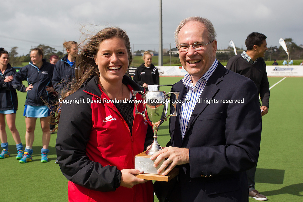 Auckland Mayor Len Brown presents Canterbury's Sian Fremaux with highest goalscorer of the tournament award after the Auckland v Northern Women`s Final match, Ford National Hockey League, North Harbour Hockey Stadium, Auckland, New Zealand,Sunday, September 14, 2014. Photo: David Rowland/Photosport