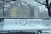 """I love Paris,"" written in the snow on a park bench near Notre dame Cathedral - Photograph by Owen Franken"