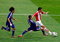 Marcus Tulio Tanaka of Japan vs Lucas Barrios of Paraguay during the 2010 FIFA World Cup South Africa Round of Sixteen football match between Paraguay and Japan on June 29, 2010 at Loftus Versfeld Stadium in Tshwane/Pretoria. (Photo by Vid Ponikvar / Sportida)