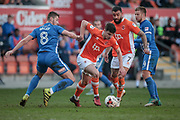 Jordan Flores (Blackpool) beats Brad Walker (Hartlepool United) to the ball during the EFL Sky Bet League 2 match between Blackpool and Hartlepool United at Bloomfield Road, Blackpool, England on 25 March 2017. Photo by Mark P Doherty.