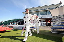 Somerset's Marcus Trescothick and Johann Myburgh walk out to bat for the first time this season.- Photo mandatory by-line: Harry Trump/JMP - Mobile: 07966 386802 - 12/04/15 - SPORT - CRICKET - LVCC County Championship - Day 1 - Somerset v Durham - The County Ground, Taunton, England.