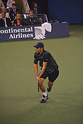 Flushing Meadows, Queens, New York, August 31 2009: Andy Roddick (USA) goes for a two-handed backhand return in his opening match against Bjorn Phau (GER)  at the US OPEN at  Arthur Ashe Stadium, The USTA Billie Jean King National Tennis Center, Queens, New York, United States. Roddick won that match 6-1, 6-4, 6-2. Close up shot. EDITORIAL USE ONLY