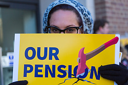 A woman holds up a strike placard at the picket line outside Birkbeck College on the UCL campus. Students and staff at UCL man picket lines as and estimated 40,000 University and College Union (UCU) lecturers and academics across the UK strike over changes to their pensions. The strike is the first in a planned series of 14 days of walkouts. UCL, London, February 22 2018.