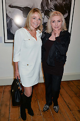 Left to right, HELEN FIELDING and DEBBIE HARRY at a private view of Chris Stein/Negative: Me, Blondie And The Advent Of Punk, held at Somerset House, The Strand, London on 5th November 2014.