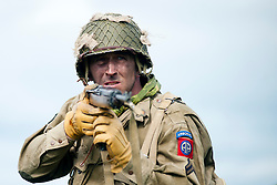 Reeactor portraying a paratrooper Corpral from the US 82nd Airborne (All American) carrying an M1 Carbine.21 April  2013.Image © Paul David Drabble