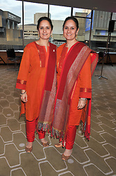 Left to right, artists RABINDRA KAUR SINGH and AMRIT KAUR SINGH known as The Singh Twins at a private view of photographs by Joanna Vestey entitled 'Dreams For My Daughter' in aid of The White Ribbon Alliance, held at The Royal Festival Hall, South Bank, London on 8th March 2012.