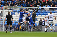 Jordan Archer, the goalkeeper of Millwall makes a save to keep out Sean Morrison (l) and Craig Bryson of Cardiff City (21).EFL Skybet championship match, Cardiff city v Millwall at the Cardiff city stadium in Cardiff, South Wales on Saturday 28th October 2017.<br /> pic by Andrew Orchard, Andrew Orchard sports photography.