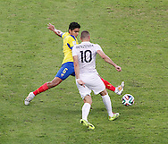 Karim Benzema of France puts the ball just past Christian Noboa of Ecuador during the 2014 FIFA World Cup Group E match at Maracana Stadium, Rio de Janeiro<br /> Picture by Andrew Tobin/Focus Images Ltd +44 7710 761829<br /> 25/06/2014