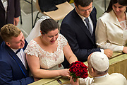 January 03, 2018: A bride gives Pope Francis her wedding bouquet of red flowers at the end of his weekly general audience in Paul VI hall at the Vatican, Rome, Italy.<br /> *** RESTRICTED TO EDITORIAL USE - NO MARKETING NO ADVERTISING CAMPAIGNS ***