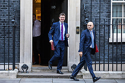 © Licensed to London News Pictures. 28/11/2017. London, UK. Secretary of State for Business, Energy and Industrial Strategy Greg Clark (L) and Secretary of State for Communities and Local Government Sajid Javid (R) leave 10 Downing Street after the weekly Cabinet meeting. Photo credit: Rob Pinney/LNP