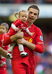 LIVERPOOL, ENGLAND - Sunday, May 11, 2014: Liverpool's Jordan Henderson with his daughter Elexa after the Premiership match against Newcastle United at Anfield. (Pic by David Rawcliffe/Propaganda)