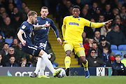 Southend United midfielder Luke Hyam (4) battles for possession with AFC Wimbledon defender Paul Kalambayi (30) during the EFL Sky Bet League 1 match between Southend United and AFC Wimbledon at Roots Hall, Southend, England on 16 March 2019.