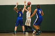 Winooski's Niki Dang (20) looks to pass the ball while being guarded by Vergennes' Nikkelette Salley (31) and Bri Gebo (3) during the girls basketball game between Vergennes and Winooski at Winooski High School on Wednesday night December 9, 2015 in Winooski. (BRIAN JENKINS/for the FREE PRESS)