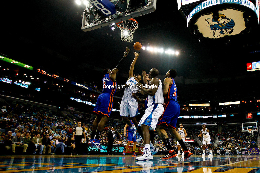 December 3, 2010; New Orleans, LA, USA; New Orleans Hornets small forward Trevor Ariza (1) shoots over New York Knicks power forward Amare Stoudemire (1) during the first half at the New Orleans Arena. Mandatory Credit: Derick E. Hingle