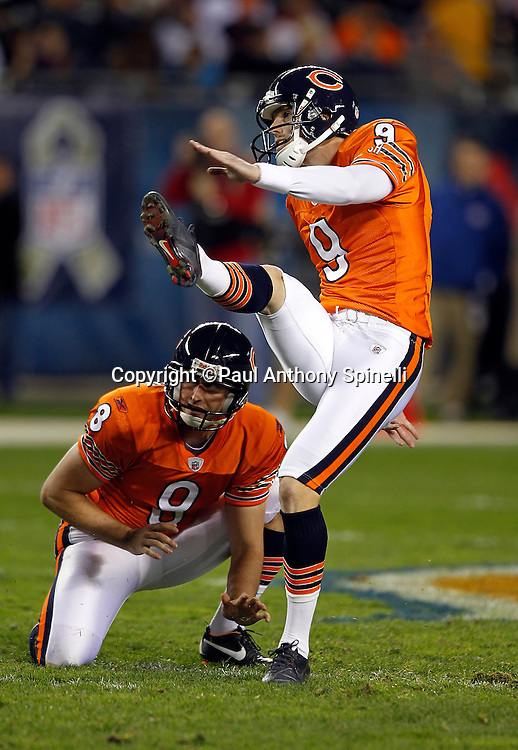 Chicago Bears kicker Robbie Gould (9) kicks a 50 yard field goal that gives the Bears a 37-6 third quarter lead during the NFL week 10 football game against the Detroit Lions on Sunday, November 13, 2011 in Chicago, Illinois. The Bears won the game 37-13. ©Paul Anthony Spinelli