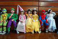 Gloucester: Kindergarten student at Fuller Elementary School paraded in their halloween costumes Friday. From left are Alex Ciluffo, George Clancy, Kara Denis, Olivia McComack, Victoria LoContro, Peter DeSimone and Jade Orlando.  (Photo by Mike Dean/Gloucester Daily Times). Friday, October 31, 2003 (NOTE: THIS IS A DIGITAL CAMERA IMAGE)..**************************************.Filter: Min (QMPro: Red Radius:0/Blue Radius:6/Desp.).USM: Normal (Amt:200/Radius:0.3/Thresh:2).File Size: 7.71MB.Original file name: DSC_9642.JPG