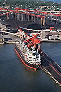 Aerial view of Cargo ship loading coal at Newport News export coal terminal on the James River. Virginia Hampton Roads. Coal from the mountains of West Virginia and Western VA is exported from here.