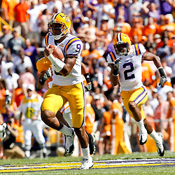Oct 2, 2010; Baton Rouge, LA, USA; LSU Tigers quarterback Jordan Jefferson (9) runs for a touchdown against the Tennessee Volunteers during the first half at Tiger Stadium.  Mandatory Credit: Derick E. Hingle