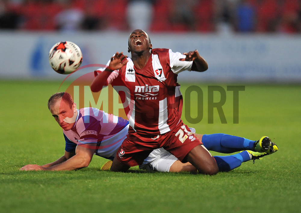 Bristol Rovers' Mark McChrystal fouls Cheltenham Town's Omari Sterling-James  - Photo mandatory by-line: Alex James/JMP - Tel: Mobile: 07966 386802 15/07/2014 - SPORT - FOOTBALL - Whaddon Road- Cheltenham  -  Cheltenham Town V Bristol Rovers - preseason