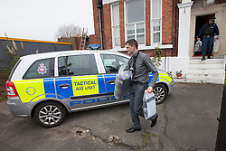 © Licensed to London News Pictures . 09/10/2012 . Altrincham , UK . Police remove computers from the house on 1 Woodlands Road , Altrincham , Cheshire today (9th October 2012) where they continue to search the premises . Police arrested Jimmy Savile's former chauffeur , Ray Teret , and housemate Alan Ledger , yesterday (8th November) over historic child rape allegations . Photo credit : Joel Goodman/LNP