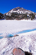 Mount Lassen from the frozen snow-covered shore of Lake Helen (Pacific Ring of Fire), Lassen Volcanic National Park, California