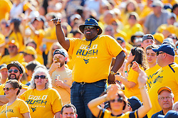 Oct 6, 2018; Morgantown, WV, USA; A West Virginia Mountaineers fan dances in the crowd during the third quarter against the Kansas Jayhawks at Mountaineer Field at Milan Puskar Stadium. Mandatory Credit: Ben Queen-USA TODAY Sports