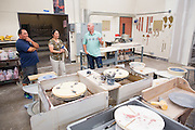 Ceramics teacher Jeff Albrech talks with parents Kevin Balsbaugh and Barbara Knitter during Milpitas High School's Back to School Night at Milpitas High School in Milpitas, California, on September 1, 2015. (Stan Olszewski/SOSKIphoto)