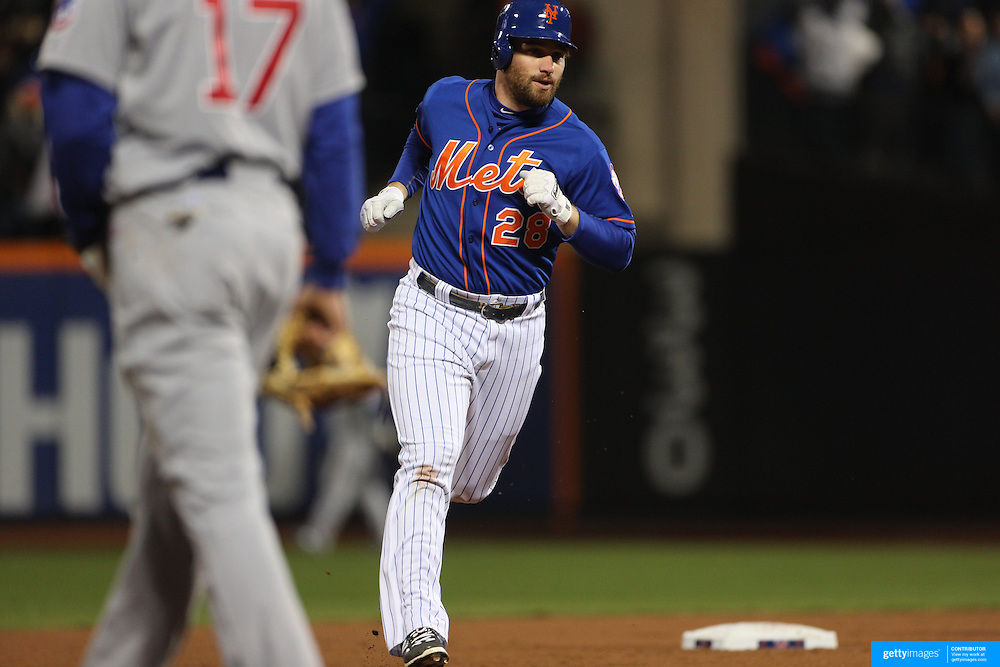 Daniel Murphy, New York Mets, celebrates after hitting ahome run as he runs the bases during the MLB NLCS Playoffs game two, Chicago Cubs vs New York Mets at Citi Field, Queens, New York. USA. 18th October 2015. Photo Tim Clayton