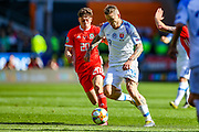 Slovakia midfielder Juraj Kucka tussles with Wales midfielder Daniel James during the UEFA European 2020 Qualifier match between Wales and Slovakia at the Cardiff City Stadium, Cardiff, Wales on 24 March 2019.