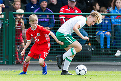 WREXHAM, WALES - Thursday, August 15, 2019: Wales' Finn Ashworth and Northern Ireland's Daniel Kirk during the UEFA Under-15's Development Tournament match between Wales and Northern Ireland at Colliers Park. (Pic by Paul Greenwood/Propaganda)