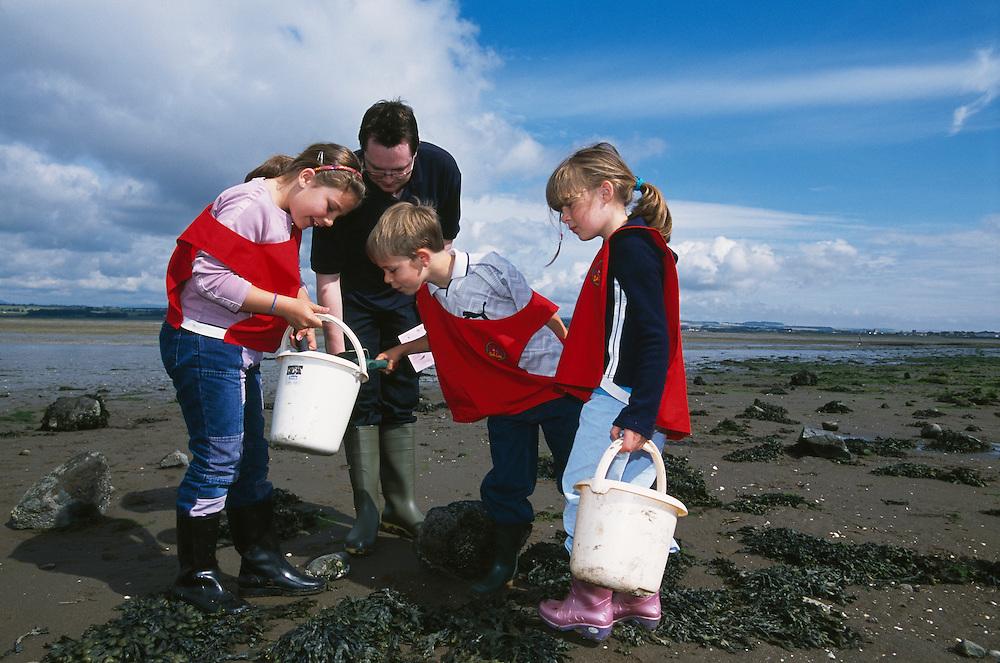 Children examining shore finds, Montrose Basin, Scotland