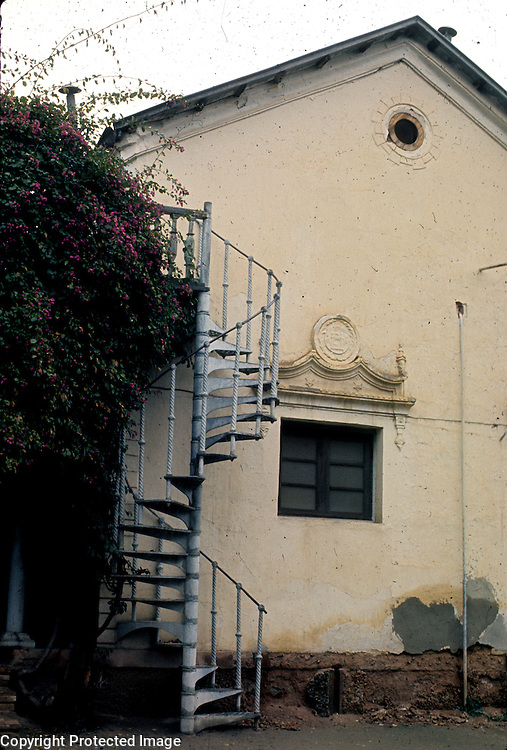 February 1976<br /> Metal spiral staircases imported from India were attached to most elite houses during this period. Used by servants carrying water to the bathrooms and cleaning toilet boxes.
