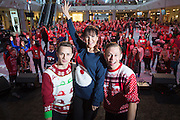 Choreographer Arlene Phillips with dancers Ashley & Ashley lead Save the Children supporters in a dance as they attempt to break the Guinness World Record for the most people wearing Christmas jumpers in one place at Westfield London, W12, on Christmas Jumper Day December 13, 2013. Donate £1 to Save the Children at www.christmasjumperday.org
