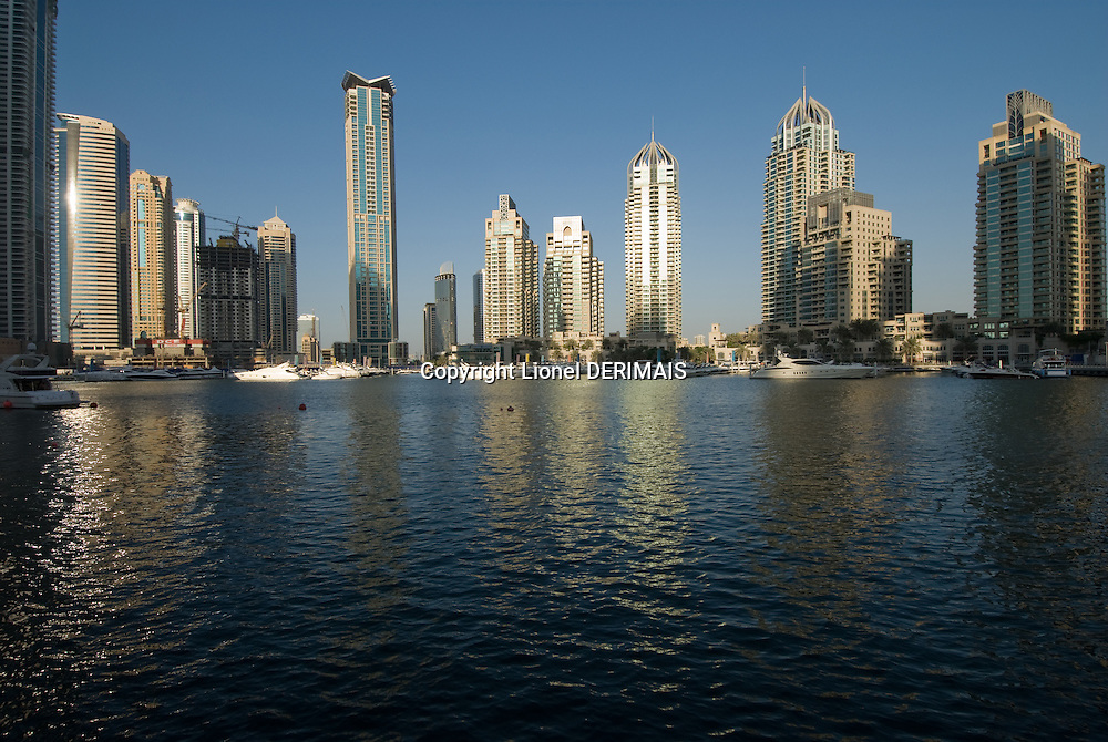Dubai marina. Dubai, one of the seven emirates and the most populous of the United Arab Emirates sits on the southern coast of the Persian gulf.