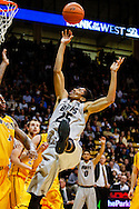 November 13th, 2013:  Colorado Buffaloes junior guard Spencer Dinwiddie (25) floats a shot up in the second half of action in the NCAA Basketball game between the University of Wyoming Cowboys and the University of Colorado Buffaloes at the Coors Events Center in Boulder, Colorado