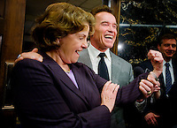 Governor Arnold Schwarzenegger feels the muscles of US Senator Diane Feinstein outside his office at the State Capitol, Thursday Feb. 21, 2008. Schwarzenegger was responding to the question if he needed her help to get a deal on the water bonds in California. The governor called a special session last year to hash out a deal to boost California's water supply, but lawmakers failed to broker a deal. The two sides are still divided about how to spend money on dams.