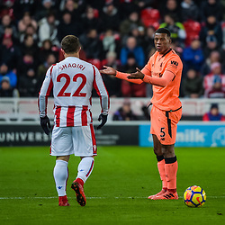 Liverpool midfielder Georginio Wijnaldum (5) and Stoke City midfielder Xherdan Shaqiri (22) during the Premier League match between Stoke City and Liverpool<br /> (c) John Baguley | SportPix.org.uk